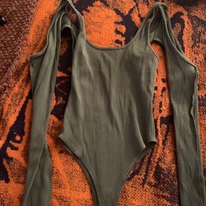 Green body suit sleeves cut out